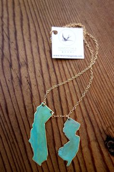 Live & Love 2 State Necklace by NINOTCHKAgoods on Etsy would love this with California & North Carolina