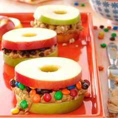 Apple and Peanut Butter Stackers (Some of any optional fillings of your choice are sprinkles, chopped nuts, chocolate chips, m, and more. You can also melt some dark chocolate in the microwave and mix with peanut butter or use Nutella instead of peanut butter)