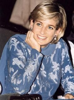 This is such a darling photo of Princess Diana who appears to be having a good time.