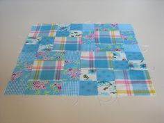 "A traditional pattern called ""Four Squares."" Pieced by Pam Wilson in August 2014, incorporating gingham and other fabrics from the stash of my aunt Johanna Wackerle Tanner."