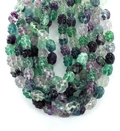 CARVED MULTI COLOR FLUORITE SPIRAL BEADS 16x12mm from New World Gems