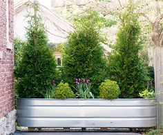What if you want to block off part of your property but not permanently?   Why moveable? Deliveries, etc. Put a planter on casters. You don't have to use a feed tank. Posted on BHG.com