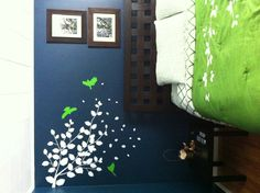 Dark blue bedroom with bright green accents Wall color: Behr 'Restless Sea' Bedding: Kate Spade Wall Decal: PopDecals on Etsy