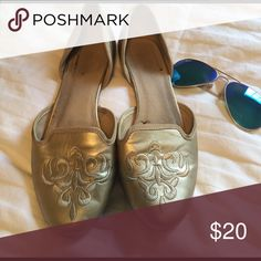 Gold Flats All gold flats. Are extremely comfortable and easy to walk in. Have been worn a lot so there are creases in the front and it is a bit distressed inside, as well as worn on the bottoms. Shoes Flats & Loafers