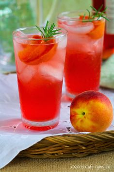 Rosemary, Peach, and White Wine Spritzer: 3/4 cup sugar, 1 1/2 cups water, 4 large ripe peaches (about 1 3/4 pounds), halved, pitted, and cut into 1-inch slices, 4 sprigs rosemary, plus more for garnish, Ice, 4 cups cold white or rose wine, 1 liter cold club soda