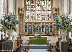 North Cadbury church in Somerset fully decorated with two large plinth designs and alter flowers. The Wilde Bunch moved the plinths back to the reception venue after the ceremony, thus doubling their effective use and appeal. Alter Flowers, Aisle Flowers, Pillar Design, Church Wedding Flowers, Country House Wedding Venues, London Bride, Fresco, Reception, Photo Wall