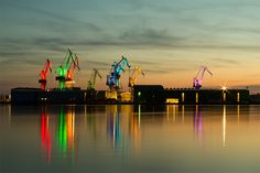 Illuminated Shipyard Cranes Transform Into Glowing Origami Dancers