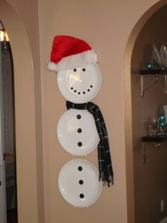 thrift store plates, scarf and hat with a package of black buttons from michael's or joanns and viola!  a snowman for that little space you don't know how to decorate! :)
