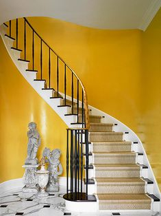 Antique stone cherubs from the century balance the sculptural presence of the winding staircase. - Traditional Home ® / Photo: Robert Brantley / Design: Lee Bierly and Chris Drake Yellow Hallway, Yellow Walls, Yellow Rooms, Gold Walls, Winding Staircase, Grand Staircase, Staircase Design, White Stairs, Yellow Stairs