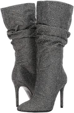54eaf001a22 Jessica Simpson · Sparkling crystals shimmer all over a slouchy boot lofted  by a slim stiletto heel High Heel