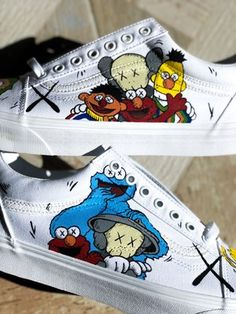 *Please allow 3 to 4 weeks for delivery of any custom order* KAWS x Sesame Street collaboration. Vans Old Skools. Waterproofed with beeswax. Custom Slip On Vans, Customised Vans, Custom Vans Shoes, Custom Painted Shoes, Custom Sneakers, Tennis Vans, White Canvas Shoes, Girls Football Boots, Nike Shoes Air Force