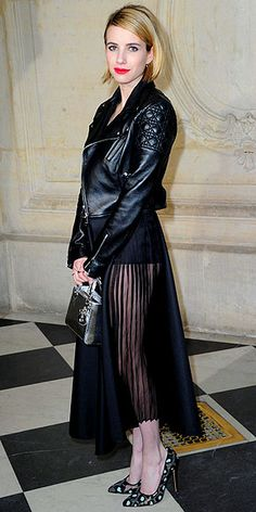 Love Her Outfit! | EMMA ROBERTS | It's as if the Sandy from the beginning of Grease crossed with the Sandy from the end of Grease and the result is this edgy-meets-ladylike look: full skirt, dainty heels, badass bomber, statement bag, bold lip and smoky eye.