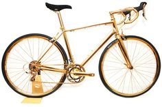 goldgenie,frank fernando,gold,or,platine,platinum,vélo en or,golden bike,giant,bicyclette,prestige,rare,exclusif,exclusive,luxe,luxury,or rose,gold pink