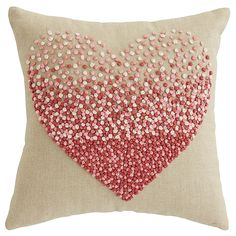 Add a touch of romance with Pier 1's Ombre Heart Mini Pillow, featuring a French-knotted heart in gradient shades of pink and red.