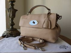 Mulberry Postmans Lock Satchel in Pebbled Beige Glossy Goat Leather  > http://www.npnbags.co.uk/naughtipidginsnestshop/prod_3817267-Mulberry-Postmans-Lock-Satchel-in-Pebbled-Beige-Glossy-Goat-Leather.html