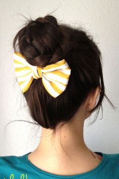 I love that the bow is under the bun it would help to hold the too short hairs up