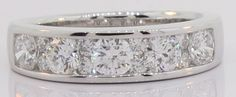 Platinum #WeddingRing with enormous Channel Set Round Brilliant cut diamonds