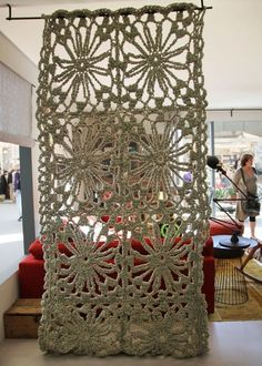 room divider?  Need to click through to the link and see all the household decor, knitting gone crazy!