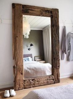 3 Scandinavian Country Furnishings with light reclaimed lumber mirror, and light colors through out the room.