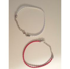 Chose between White or Red Bracelets. Adjustable chain attached to fit most wrists or ankles.