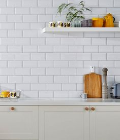 Metro White Tile - laid going end to end up the wall, with a dark grey grout to match the floor