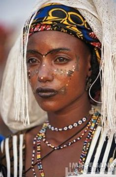 Fulani woman - Explore the World with Travel Nerd Nici, one Country at a Time. http://TravelNerdNici.com
