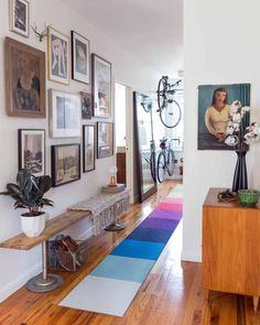 entryway with art, bikes, and colorful runner