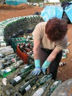 Spain Earthship Images - completely self sustaining DIY homes made of recycled garbage. Our GM has a similar wine bottle wall at her bach made from our empties! Build extra storage house inspired by Earth Ships Beautiful homes made from recycled materials