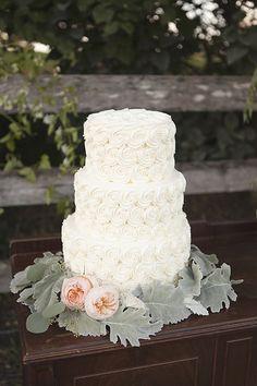 simple white wedding cake #weddingcake #simpleweddingcake #weddingchicks http://www.weddingchicks.com/2014/01/27/pastel-sheep-wedding-inspiration
