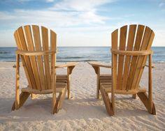 Adirondack chairs on a lake...