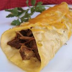 """Shredded Beef Enchiladas. A friend made these for us and they were so so yummy. """"I think I might have poured a can of Old El Paso Red echilada sauce over your pan before the cheese, both with or without the red sauce is """"good. This recipe does make a lot (1 9x13 and 1 8x8), just FYI."""