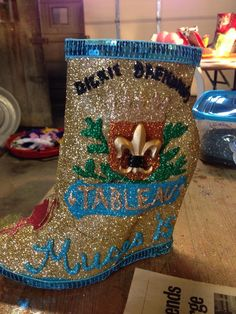 A close up of beautiful Krewe of Muses shoe presented to Dickie Brennan at Tableau created by talented artisan Katina Spera (via the Muses Flamingos Facebook Page)
