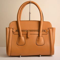 This handbag by Dissona has a top zipper with an inside middle zipper compartment as well as side compartments for all essentials, a front zipper compartment, and a removable shoulder strap. Cole Haan, Stuart Weitzman, Camel, Shoulder Strap, Middle, Essentials, Zipper, Top, Bags