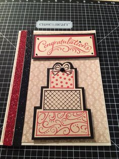 A wedding card made this weekend using CTMH  Happy Couple stamp and CTMH shimmer ribbon in black and cranberry. Used CTMH cranberry and black ink and paper from the Yuletide Carol paper pack.   www.stefaniehillmann.ctmh.com