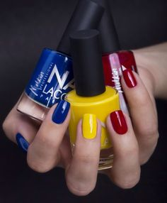 Nails painted like the Romanian flag,red, yellow and blue..perfect for the national day...1 of December
