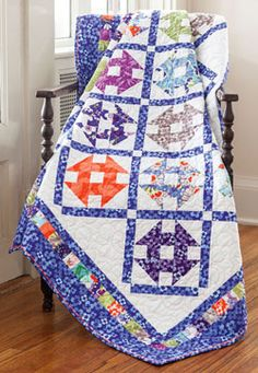 Pieced quilt borders and a thin ribbon of piping encircle the center of this quilt, Feelin Groovy, designed by Catherine Foxworth.