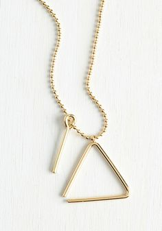 Posh Percussionist Necklace. Just as the auxiliary percussion section adds the finishing touch to a concerto, this golden necklace perfects your ensemble! #gold #modcloth
