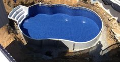 Before its backfilled 16x28. Metric Radiant Freeform pool