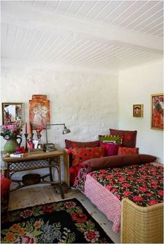 cozy, eclectic, bohemian bedroom, red bedding, white walls, white beams; via that bohemian girl