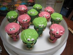 StoryBots ice cream cone cupcakes! Baked in the cones themselves. Stretch foil over the cupcake pan and make criss-cross slits to keep them put. After they cooled, ice them, add Wilton candy eyes, and cheerios for hands and feet.