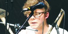 5SOS - 5 Seconds of Summer - Ashton Irwin in glasses playing the drums -Sugarscape.com