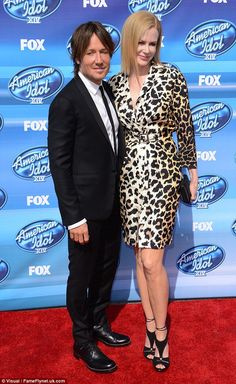 Wild thing: Nicole Kidman stood out in an animal print dress as she arrived at the American Idol XIV finale with husband Keith Urban at the Dolby Theatre in Hollywood on Wednesday