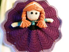 """A handmade crocheted Anna lovey inspired by Disney's """"Frozen"""". My daughter loves playing with this and I'm sure your child will too!  Machine washable and dryable and made in a smoke free home.  Please specify in the notes if you want anything different than the pictures. Otherwise, it will be made exactly as shown.  Please check out my friend's site if you are interested in an Elsa doll instead https://www.etsy.com/listing/184512855/crochet-disney-frozen-princess-blanket?ref=pr_faveshops"""
