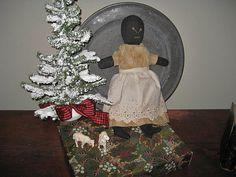 Sweet little Black sock doll with brown dress....
