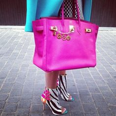 These are a sure sign of a Margarita Girl- a handbag that can hold a kitchen sink (and does), zebra ankle boots and a gorgeous riotous combo of aqua and shocking pink!  Paparazzi ready? Over the top? Yes! So we love it and her? Absolutely! Living out Loud!!