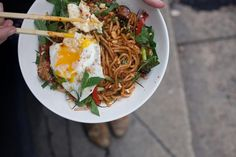 Kung pao noodles with soy marinated chicken thighs and fried egg