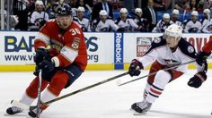 The latest: Petrovich stays with the Panthers of Florida