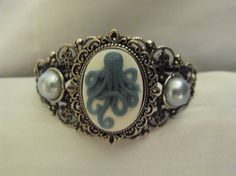 Steampunk Octopus Cameo Cuff Bracelet. $22.50, via Etsy. - Gail Carriger would be proud!
