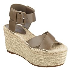 8375d1376a2 Criss-cross leather straps and braided rope covers this wedge platform  espadrille sandal. Towering