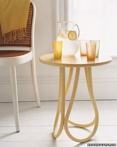 The interior rails of three beleaguered bistro chairs form the legs of this petite side table, which has been painted a mellow shade of yellow.